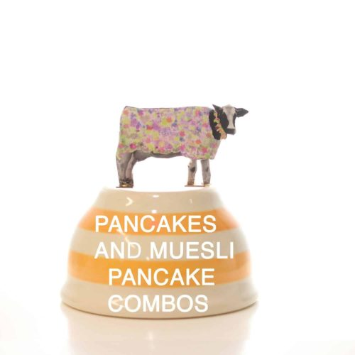 A bowl that says pancakes and muesli pancake combos from the muesli shop