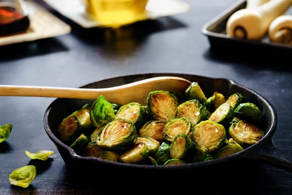 cast iron skillet with sliced brussels sprouts